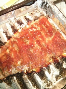 Thawed & rinsed. Place skin side down on pan. Dropped butter pieces on top & sprinkled Mrs. Dash, Italian seasoning & a dash of smoked paparika. Place in over heated at 400 degrees til butter melted. While in oven, I mixed equal parts of honey & ketchup(yes, ketchup..lol) Mix enough according to how much you want on the salmon. Removed from oven & spread mixture over salmon & returned to oven til done. Flaked when forked! :-)